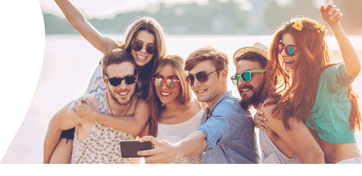 Group of friends on Jersey beach using their JT pay as you go mobile deal